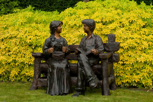 Couple Seated on Rustic Bench